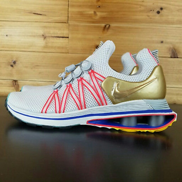 08c993c5e36 Nike Men s Shox Gravity Vast Grey Metallic Gold Si